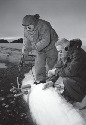 Scientists lower a current meter into the frigid...