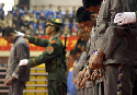 Chinese police present a group of convicted...