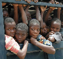 Nigerian slave children are transported to safety...
