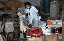 A federal officer examines chemicals and...