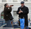 Russian men drink beer and hard liquor on the...