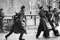 East German police arrest a photographer near the...