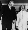 U.S. Secretary of State John Dulles (left) meets...