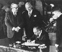 U.S. Secretary of State Dean Acheson signs the...