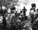 South Vietnamese troops round up Viet Cong...