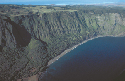 High, near vertical cliffs eroded into volcanic...