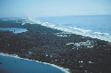 The low-relief sandy coastline along the Gold...