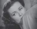 Joan Bennett as Peggy in The Woman on...