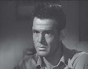 Robert Ryan as Scott in The Woman on...